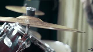 Musician playing drums at studio, close up, slow motion