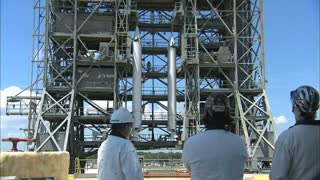 NASA Workers Observing Rocket Engines
