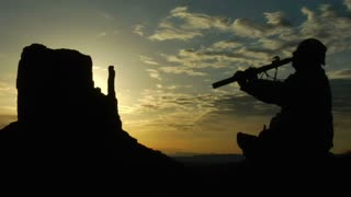 Native American Playing Flute With Monument Valley Sunrise