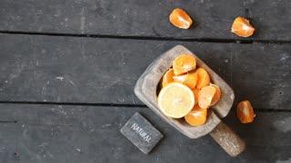natural food idea, slices of mandarin, lemon and text