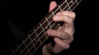 Neck of Bass Guitar Played