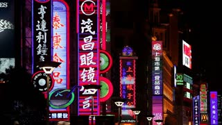 Neon signs above shops along Nanjing Road, Shanghai, China, Asia