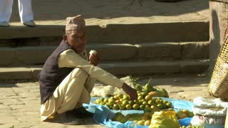 Nepali Man Eats Garlic in Market 2