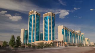 New business district timelapse hyperlapse with traffic on road and green modern towers in the capital of Kazakhstan in Astana. 4K