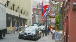 New Orleans French Quarter With Sneaky Pete's Bar Sign