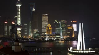 New Pudong Illuminated skyline, looking across the Huangpu River from the Bund, Shanghai, China, T/Lapse