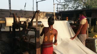 Newly dyed fabric being washed and rolled, Sari garment factory, Rajasthan, India, Asia