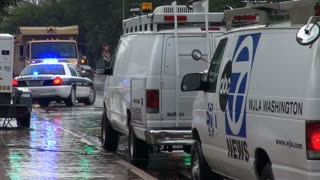 News Trucks Lined Up Behind Police Car