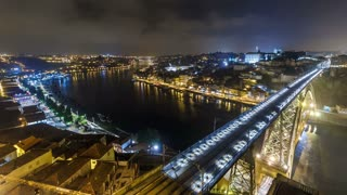 Night view of the historic city of Porto, Portugal timelapse with the Dom Luiz bridge 4K