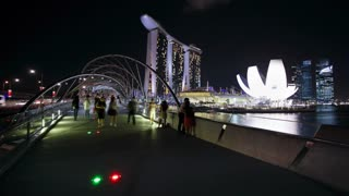 Night view of the illuminated Helix Bridge and Marina Bay Sands Singapore, Marina Bay, Singapore, Asia, Time lapse