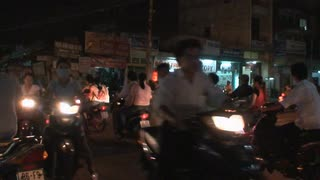 Nighttime Vietnamese Scooter Riders