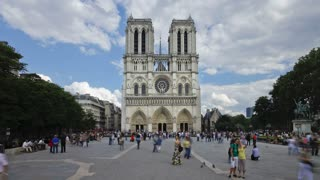 Notre Dame Cathedral a famous Landmark in the center of Paris with many tourists visiting, France, Europe, T/Lapse