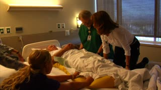 Nurses Moving Paitient From One Bed To Another