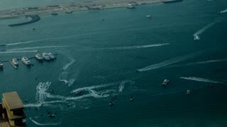 oats and jet skis float on the sea competing with each other. Time lapse 4k