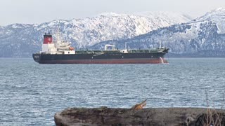 Oil Tanker By Snowy Mountains
