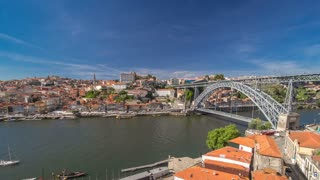 Old colorful houses in old part of Porto and embankment, view from cabine of cable car over  Douro river from  the Dom Luiz bridge  timelapse hyperlapse 4K