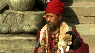 Old Nepali Man Holding Puppies on Stone Steps 5