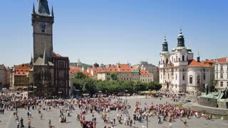 Old Town, Stare Mesto Square looking towards St Nicholas Church and the Town Hall, Prague, Czech Republic, Europe, T/Lapse