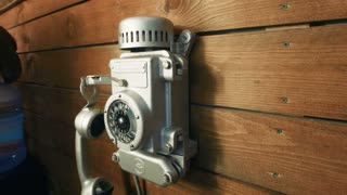 Old vintage silver interior telephone on wooden wall