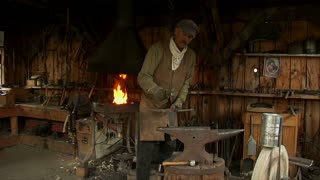 Old West Blacksmith Works With Anvil