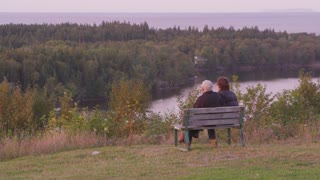 Older Couple on Bench Overlooking Bay
