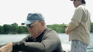 Older Men Fishing on Boat