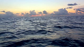 Open seas. Open water. Ocean waves during sunset golden hour time