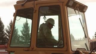 Operator Exits Backhoe