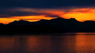Orange Sunset Behind Alaskan Mountain Range