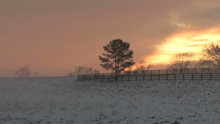 Orange Sunset Over Snowy Field Panning