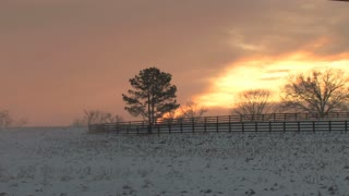 Orange Sunset Over Snowy Field