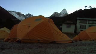 Orange Tents Pitched Near Building Below Ama Dablam