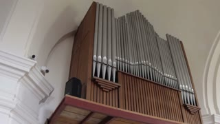 Organ Pipes And Cross In Church
