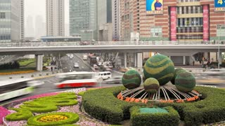 Ornate Flower traffic Island around a Circular pedestrian walkway above a traffic roundabout, Century Avenue, Pudong, Shanghai, China, Asia, T/Lapse