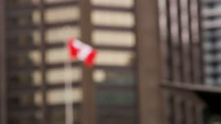 Out of Focus Canadian Flag Blowing in Wind