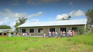 Painting the Exterior of a School in Kenya Village 3
