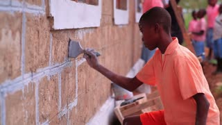 Painting the Exterior of a School in Kenya Village 4