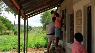 Painting the Exterior of a School in Kenya Village