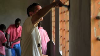 Painting the Inside of a School in Kenya Village 11