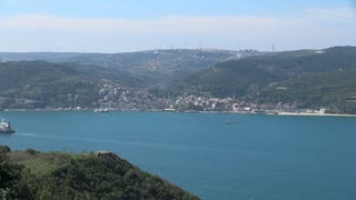 Pan Across Cargo Ships Entering Bosphorus