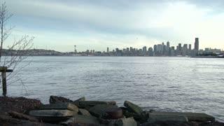 Pan across Seattle cityscape shore