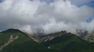 Pan Around Cloudy Mountain Peaks