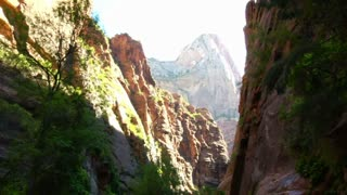 Pan Down, Canyon Walls To Hiking Family