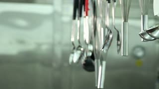 Pan Of Professional Cooking Tools Hanging In Line