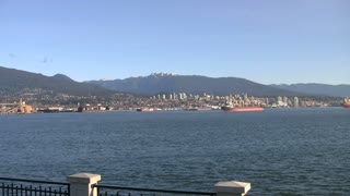 Pan of Vancouver City Skyline and Mountains