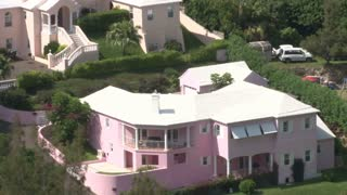 Pan Over Two Giant Pink Houses in Bermuda
