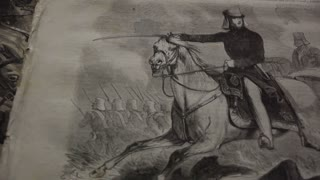 pan right on Civil War era engraving of man with sword leading cavalry charge