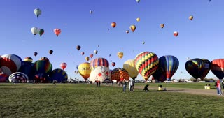 Pan up to reveal hundreds of hot air balloons at Albuquerque Hot Air Balloon Fiesta 2016