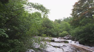 Panning Down From Sky To Rocky Clearing With Fast-moving Mountain Stream, Blue Ridge Mountains