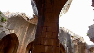 Panning Shot of Stone Archways in Ruins 2